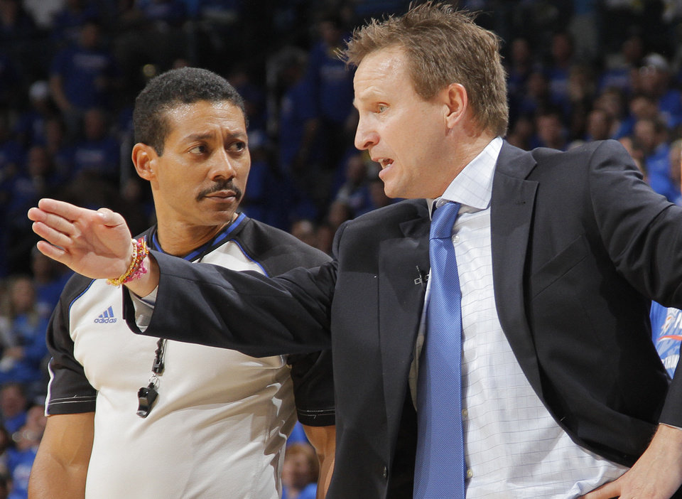 Photo - Thunder coach Scott Brooks argues with the official about a call during the first round NBA playoff game between the Oklahoma City Thunder and the Denver Nuggets on Sunday, April 17, 2011, in Oklahoma City, Okla. Photo by Chris Landsberger, The Oklahoman