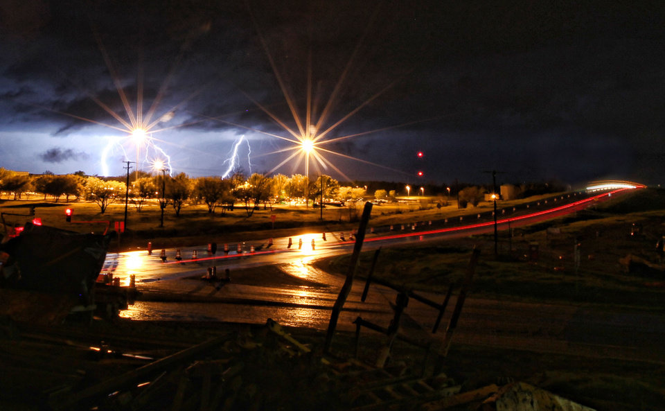 Lightning rips through the sky behind the Kimberly Clark plant in Paris, Texas Monday, March 19, 2012 as severe thunderstorms moved through North East Texas dumping inches of rain and heavy winds along the way. (AP Photo/The Paris News, Sam Craft) MANDATORY CREDIT