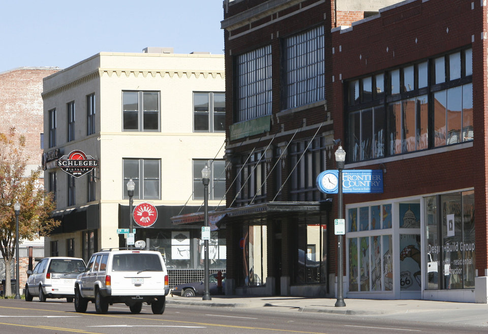Photo - BUILDING EXTERIOR: These are some of the businesses in downtown Oklahoma City, OK, Tuesday, Dec. 2, 2008. Schlegel Bicycles is far left. Automobile Alley. BY PAUL HELLSTERN, THE OKLAHOMAN ORG XMIT: KOD
