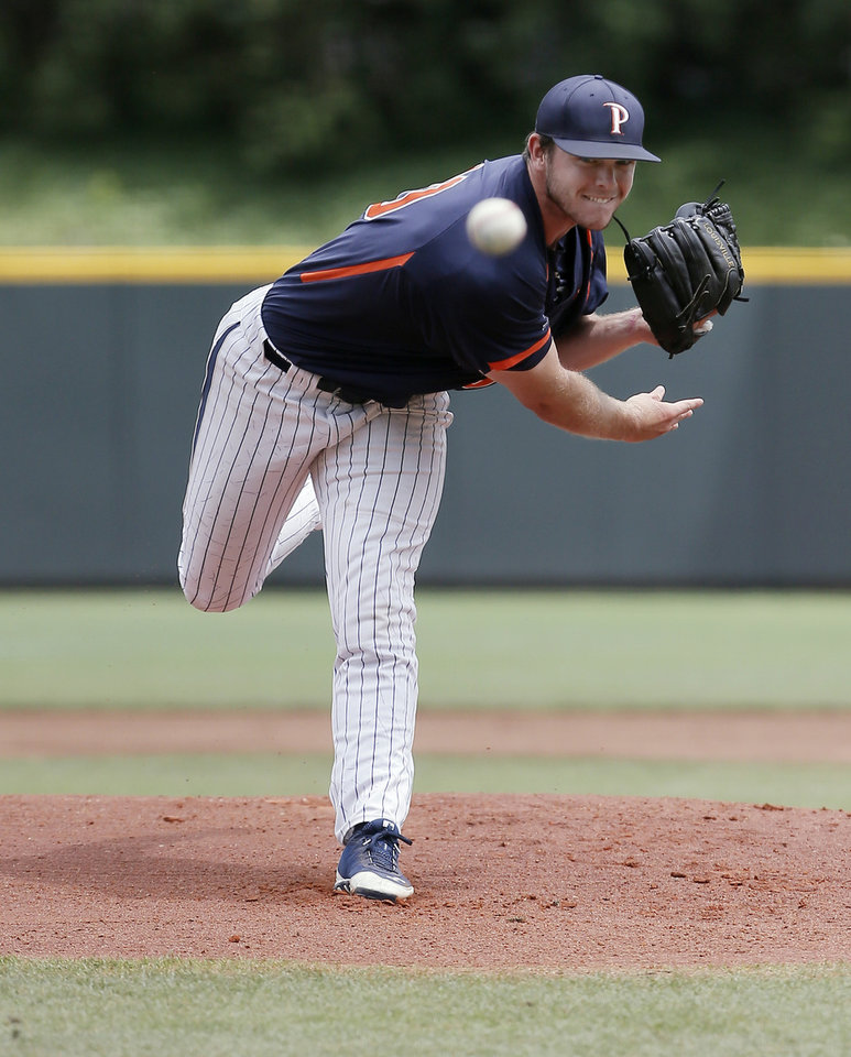 Photo - Pepperdine starting pitcher Jackson McClelland (40) throws to TCU during the first inning of an NCAA college baseball tournament super regional game in Fort Worth, Texas, Monday, June 9, 2014. (AP Photo/Brandon Wade)