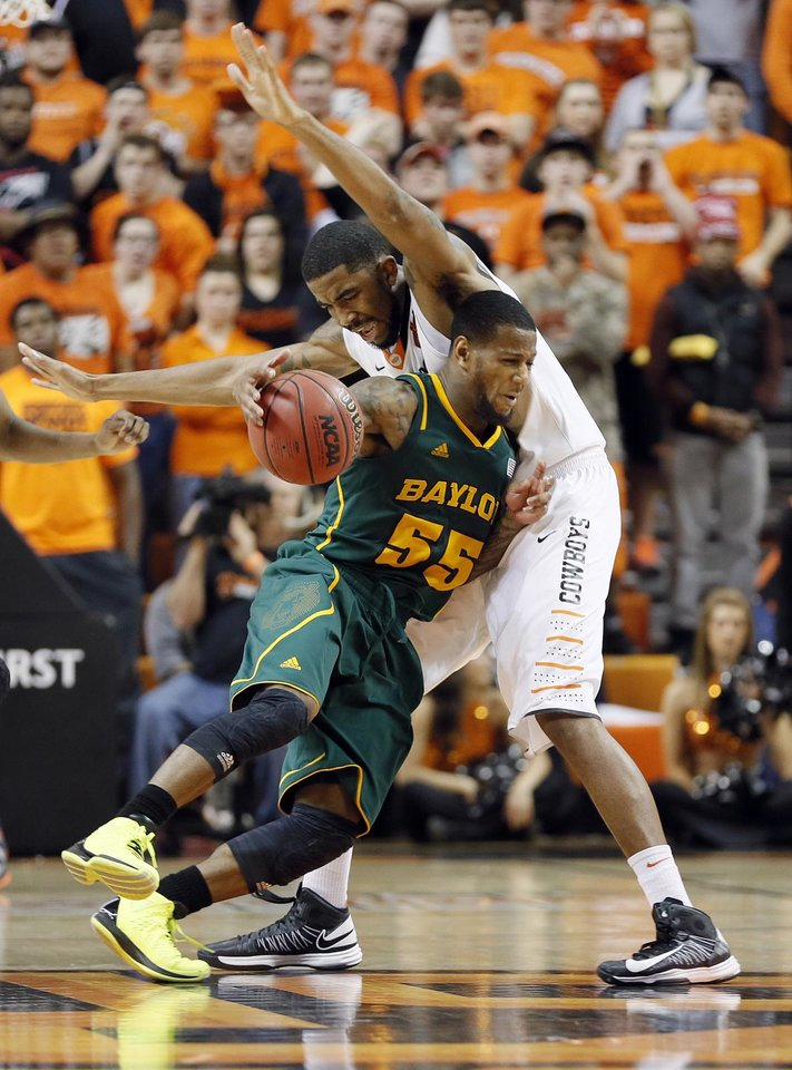 Baylor's Pierre Jackson (55) collides with Oklahoma State 's Michael Cobbins (20) during the college basketball game between the Oklahoma State University Cowboys (OSU) and the Baylor University Bears (BU) at Gallagher-Iba Arena on Wednesday, Feb. 5, 2013, in Stillwater, Okla. Photo by Chris Landsberger, The Oklahoman