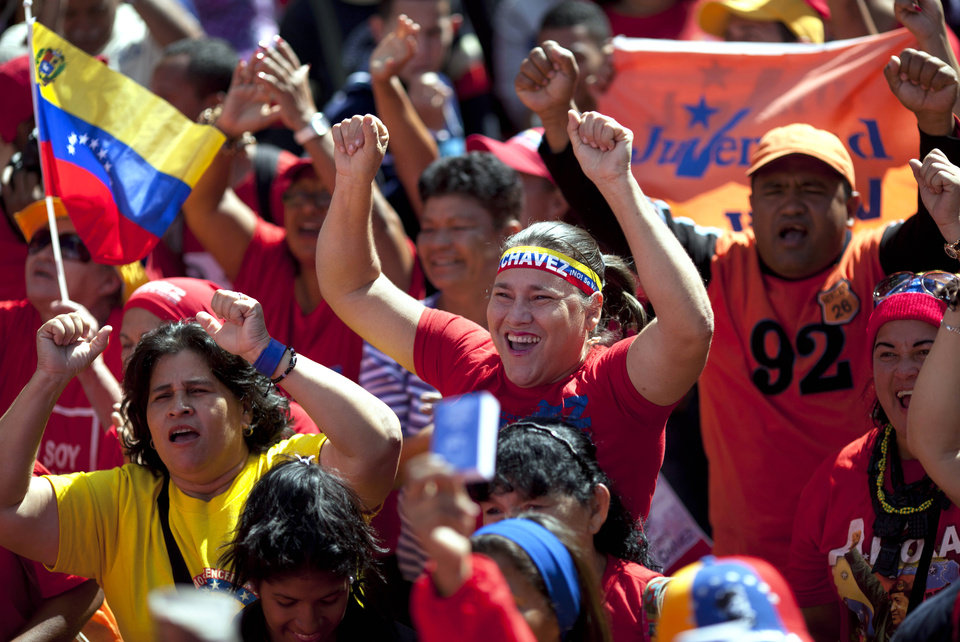 Supporters of Venezuela\'s President Hugo Chavez chant slogans as they gather for a rally in Caracas, Venezuela, Thursday, Jan. 10, 2013. The government organized the unusual show of support for the cancer-stricken leader on the streets outside Miraflores Palace on what was supposed to be his inauguration day. Vice President Nicolas Maduro said that even though it wasn\'t an official swearing-in, Thursday\'s event still marks the start of a new term for the president following his re-election in October. (AP Photo/Ariana Cubillos)