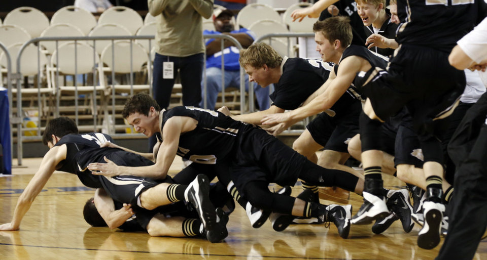 Photo - Players reacts as the Latta Panthers defeat the Haworth Lions 57-50 in the finals of the State Class 2A Boys Basketball Tournament at the Fairgrounds Arena on Saturday, March 15, 2014, in Oklahoma City, Okla. Photo by Steve Sisney, The Oklahoman