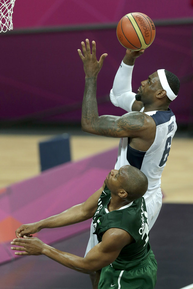 Photo -   United States' Lebron James (6) puts up a shot over Nigeria's Derrick Obasohan during a men's basketball game at the 2012 Summer Olympics, Thursday, Aug. 2, 2012, in London. (AP Photo/Charlie Riedel)