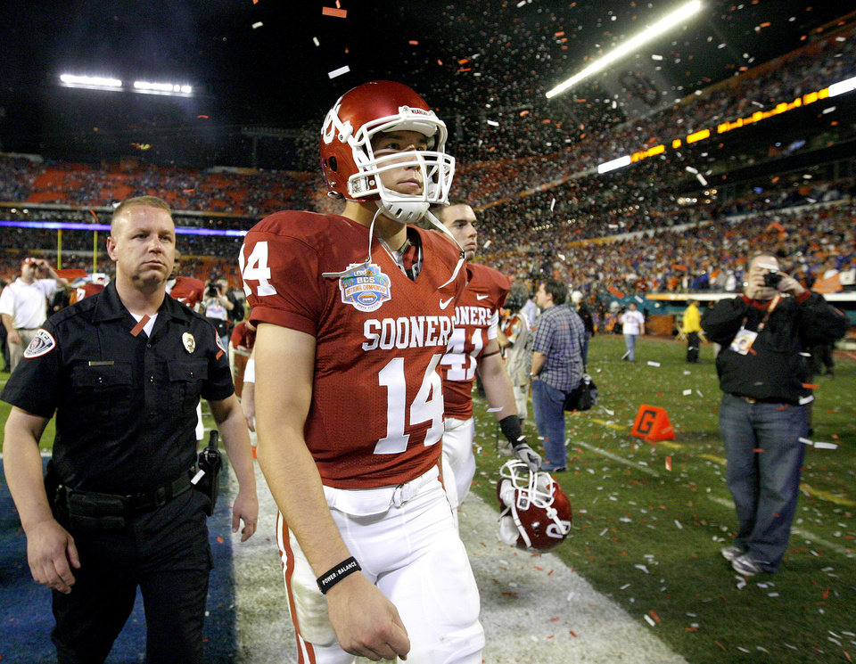 Photo - OU's Sam Bradford after OU's 24-14 loss to Florida in the BCS National Championship college football game between the University of Oklahoma Sooners (OU) and the University of Florida Gators (UF) on Thursday, Jan. 8, 2009, at Dolphin Stadium in Miami Gardens, Fla. 