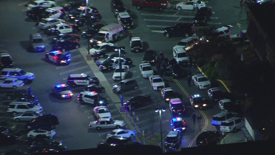 Photo - In this image provided by News 12 New Jersey, authorities converge on Garden State Plaza Mall, late Monday, Nov. 4, 2013, in Paramus, N.J., after there were reports of multiple shots being fired inside the mall. (AP Photo/News 12 New Jersey) NYC LOCAL TV OUT