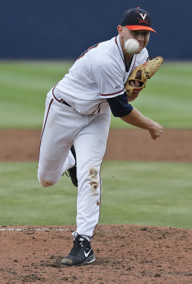 Photo - Virginia pitcher Artie Lewicki (34) pitches during the second inning of an NCAA College regional tournament baseball game against Bucknell in Charlottesville, Va., Friday, May 30, 2014.   (AP Photo/Steve Helber)