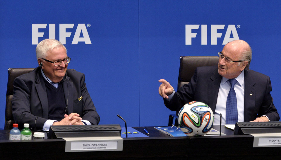Photo - FIFA President Joseph S. Blatter, right, and Theo Zwanziger, left, from germany,  Member Executive Committee, left,  chat during a press conference at the conclusion of the meeting of the FIFA Executive Committee at the Home of FIFA in Zurich, Switzerland, Friday, March 21, 2014. Among other topics, the FIFA Executive Committee covered sports political matters including an update on the workers' welfare in Qatar. (AP Photo/Keystone,Walter Bieri)