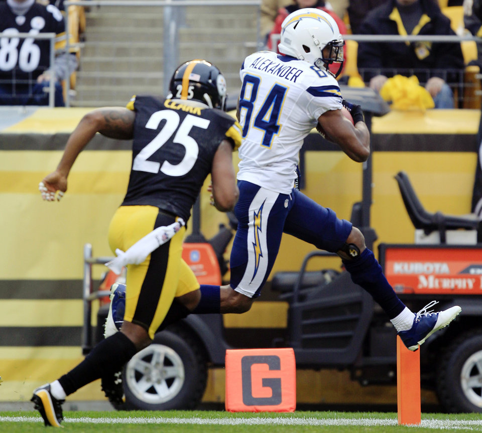 Photo - San Diego Chargers wide receiver Danario Alexander (84) leaps for the end zone to score a touchdown past Pittsburgh Steelers free safety Ryan Clark (25) after making a catch in the second quarter of an NFL football game in Pittsburgh, Sunday, Dec. 9, 2012. (AP Photo/Gene J. Puskar)