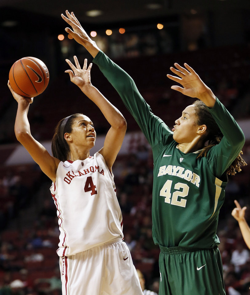 Photo - Oklahoma's Nicole Griffin (4) shoots against Baylor's Brittney Griner (42) during a women's college basketball game between the University of Oklahoma and Baylor at the Lloyd Noble Center in Norman, Okla., Monday, Feb. 25, 2013. Baylor beat OU, 86-64. Photo by Nate Billings, The Oklahoman