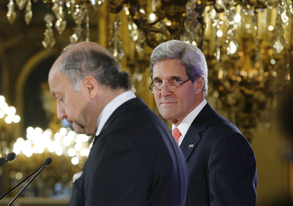 Photo - U.S. Secretary of State John Kerry, right, and France's Foreign Minister Laurent Fabius at the  Quai d' Orsay, in Paris during  their  meeting Saturday , Sept. 7, 2013. Kerry traveled to Europe to court international support for a possible strike on the Syrian regime for its alleged use of chemical weapons while making calls back home to lobby Congress where the action faces an uphill battle. (AP Photo/Jacques Brinon)