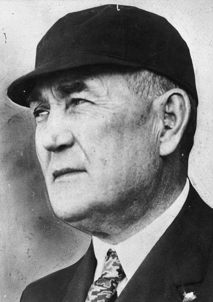 Photo - FILE - This 1935 file photo shows Major League Baseball umpire Hank O'Day, in Chicago. Former New York Yankees owner Jacob Ruppert, O'Day and barehanded catcher Deacon White were elected to the Hall of Fame on Monday, Dec. 3, 2012, for their excellence through the first half of the 20th century. (AP Photo/File)