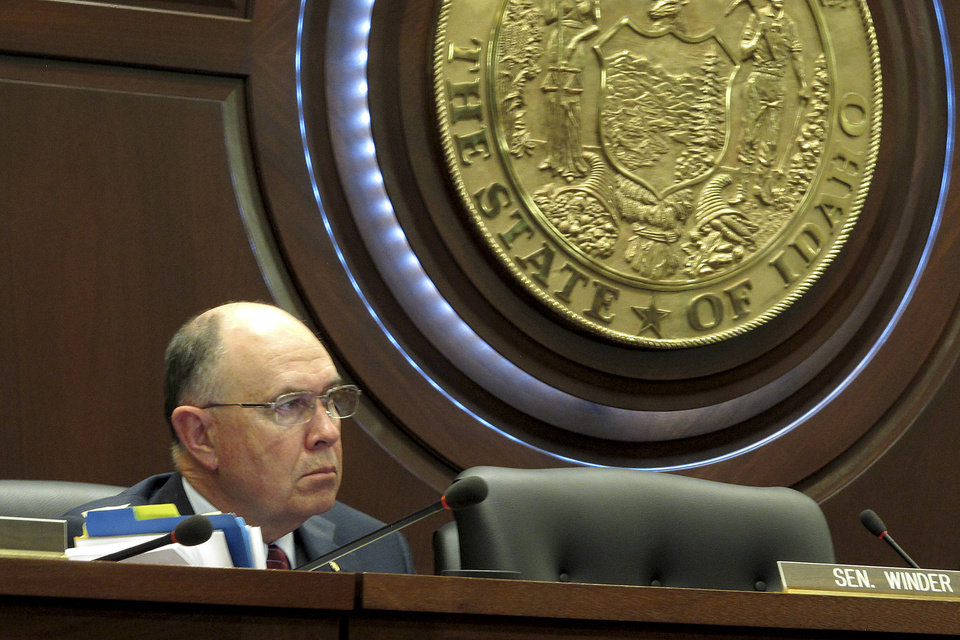 """In this March 14, 2012 photo, Sen. Chuck Winder, R-Boise, a sponsor of a bill that would require women seeking an abortion get an ultrasound first, is pictured at a Senate State Affairs Committee hearing at the Idaho Capitol in Boise. Winder's suggestion on the Senate floor that a doctor should ask a woman who says she was raped if the pregnancy could have been """"caused by normal relations in a marriage"""" brought a rebuke from another legislator who said it's insensitive and suggests women may lie to get an abortion. (AP Photo/John Miller)"""