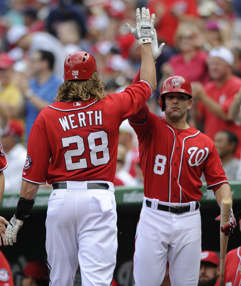 Photo - Washington Nationals' Jayson Werth (28) gets a high-five from teammate Danny Espinosa (8) after scoring on a sacrifice fly hit by Ryan Zimmerman during the first inning of a baseball game against the Atlanta Braves, Sunday, June 22, 2014, in Washington. (AP Photo/Nick Wass)