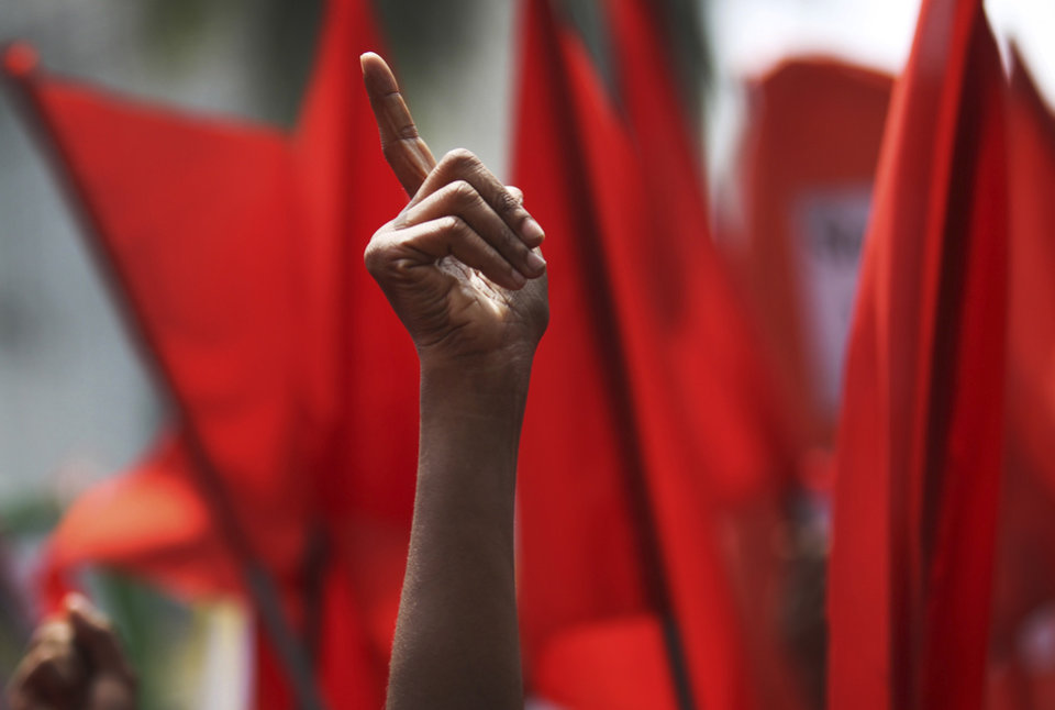 Photo - Protesters shout slogans during a May Day rally on Wednesday May 1, 2013 in Dhaka, Bangladesh. Thousands of workers paraded through central Dhaka on May Day to demand safer working conditions and the death penalty for the owner of a building housing garment factories that collapsed last week in the country's worst industrial disaster, killing at least 402 people and injuring 2,500. (AP Photo/Wong Maye-E)