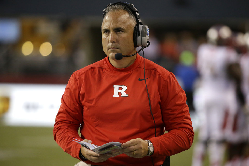Photo - Rutgers coach Kyle Flood looks toward the scoreboard in the first half of an NCAA college football game against Washington State, Thursday, Aug. 28, 2014, in Seattle. (AP Photo/Ted S. Warren)