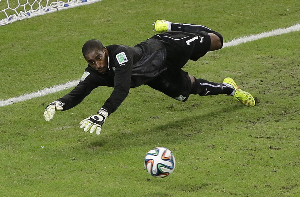 Photo - Ivory Coast's goalkeeper Boubacar Barry makes a diving save in the second half during the group C World Cup soccer match between Greece and Ivory Coast at the Arena Castelao in Fortaleza, Brazil, Tuesday, June 24, 2014. (AP Photo/Sergei Grits)