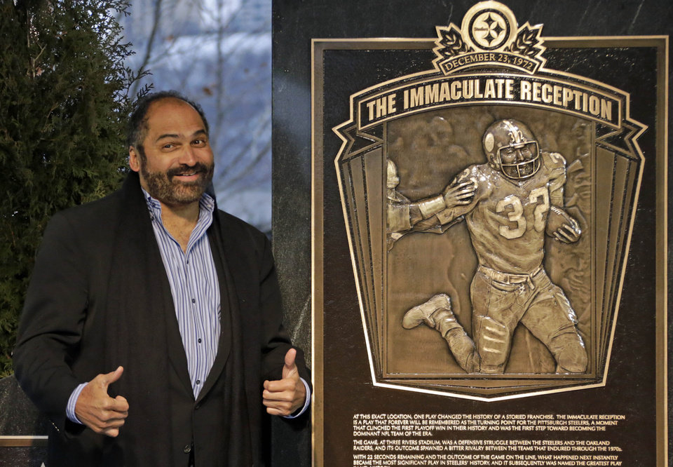 "Hall of Fame running back, Pittsburgh Steelers' Franco Harris stands on the spot of the ""Immaculate Reception"" after a marker commemorating the 40th anniversary of the play was unveiled where Three Rivers Stadium once stood on the Northside of  Pittsburgh, Saturday, Dec. 22, 2012. It is the 40th anniversary of the play in which Harris caught a deflected Terry Bradshaw pass intended for Steelers running back John ""Frenchy"" Fuqua, and returned it 42 yards for a game winning touchdown against the Oakland Raiders. (AP Photo/Gene J. Puskar)"