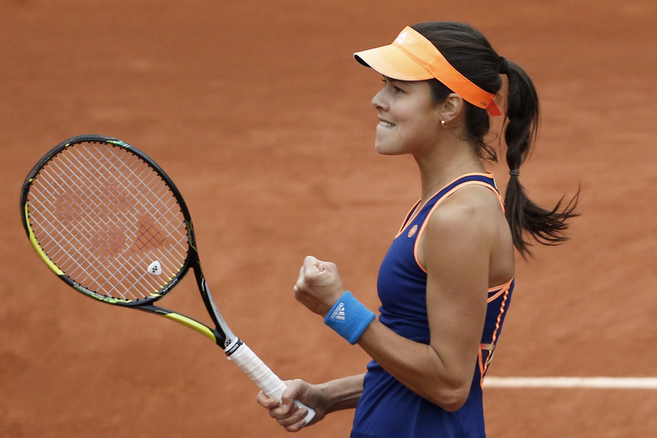 Photo - Serbia's Anna Ivanovic celebrates celebrates scoring a point in her second round match of the French Open tennis tournament against Ukraine's Elina Svitolina at the Roland Garros stadium, in Paris, France, Thursday, May 29, 2014. Ivanovic won in two sets 7-5, 6-2. (AP Photo/Darko Vojinovic)