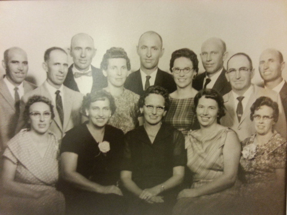 Photo - Brent's grandmother and her siblings pose for a family photo. Of the 14 siblings, 11 died from Alzheimer's. The family has a history of carrying a genetic mutation that causes the neurological disease.