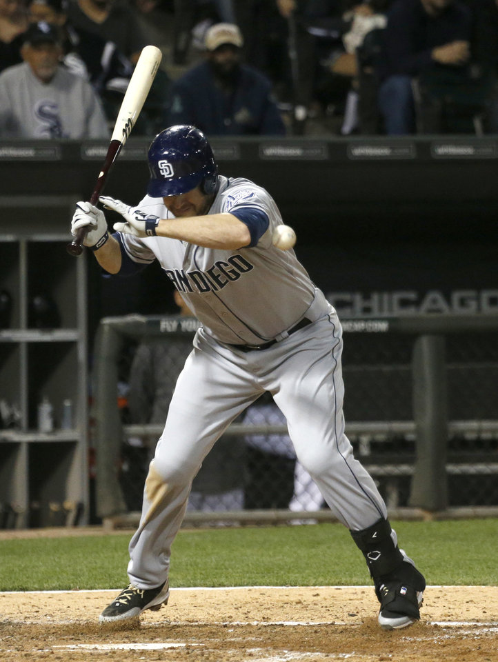 Photo - San Diego Padres' Chase Headley is hit by a pitch from Chicago White Sox starting pitcher John Danks during the fifth inning of an interleague baseball game Friday, May 30, 2014, in Chicago. (AP Photo/Charles Rex Arbogast)
