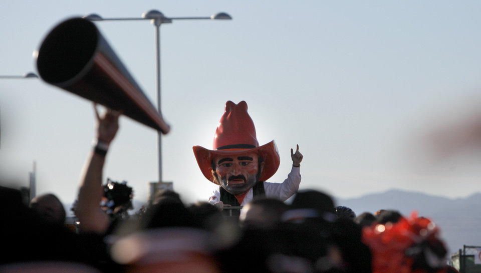Photo - Pistol Pete marches with the OSU band during the Fiesta Bowl between the Oklahoma State University Cowboys (OSU) and the Stanford Cardinal at the University of Phoenix Stadium in Glendale, Ariz., Monday, Jan. 2, 2012. Photo by Sarah Phipps, The Oklahoman