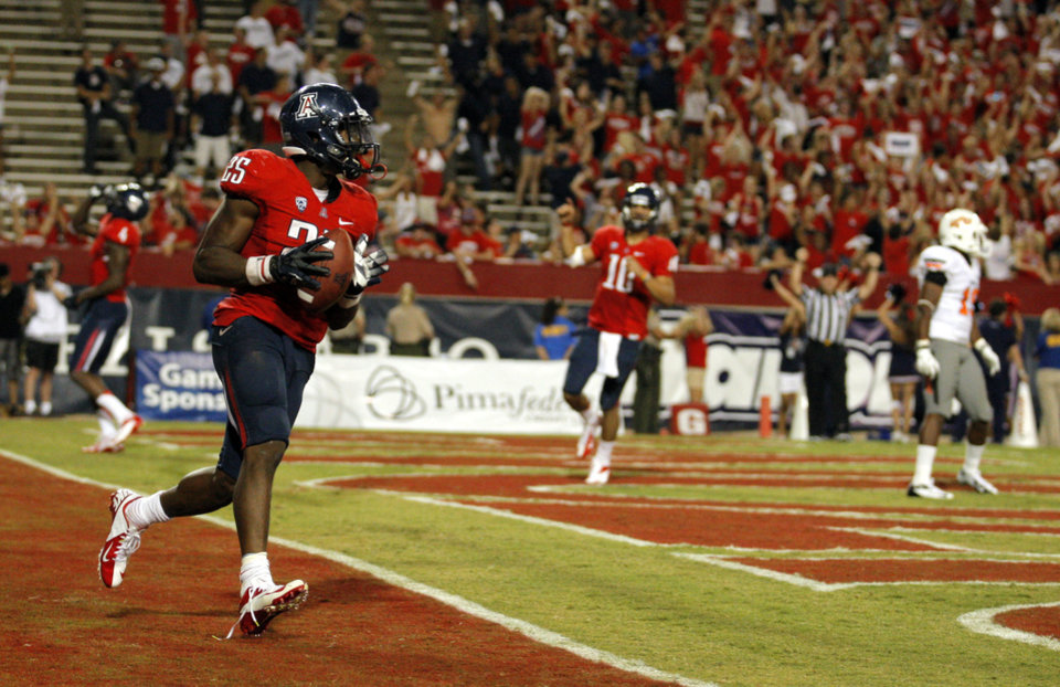 OSU / CELEBRATION: Arizona's Ka'Deem Carey (25) celebrates a touchdown during the college football game between the University  of Arizona and Oklahoma State University at Arizona Stadium in Tucson, Ariz.,  Saturday, Sept. 8, 2012. Photo by Sarah Phipps, The Oklahoman