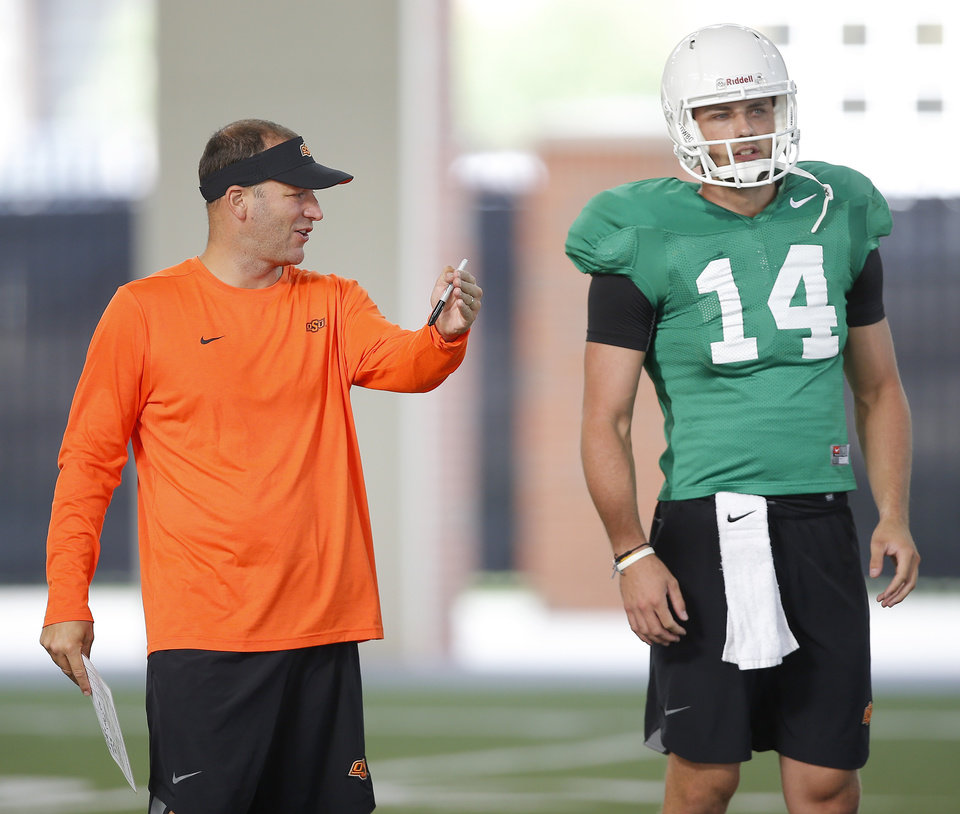 Photo - Oklahoma State offensive coordinator Mike Yurcich gives instructions to Taylor Cornelius during an OSU football practice in Stillwater, Okla., Saturday, Aug. 4, 2018. Photo by Bryan Terry, The Oklahoman