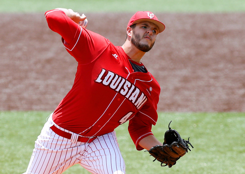 Photo - Louisiana-Lafayette pitcher Carson Baranik throws in the first inning during an NCAA college baseball tournament regional game against San Diego State in Lafayette, La., Saturday, May 31, 2014. (AP Photo/Jonathan Bachman)