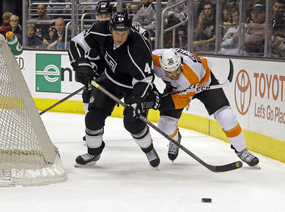 Photo - Los Angeles Kings defenseman Robyn Regehr (44) and Philadelphia Flyers center Zac Rinaldo (36) battle in the first period of an NHL hockey game in Los Angeles Saturday, Feb. 1, 2014.  (AP Photo/Reed Saxon)