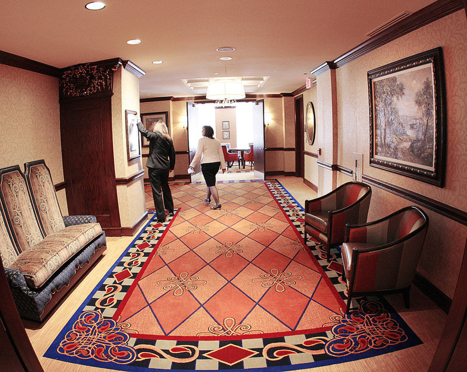 Women walk down a colorful hallway on the second floor of the Skirvin Hilton in 2007 in downtown Oklahoma City. Photo By Jim Beckel, The Oklahoman Archive JIM BECKEL - THE OKLAHOMAN