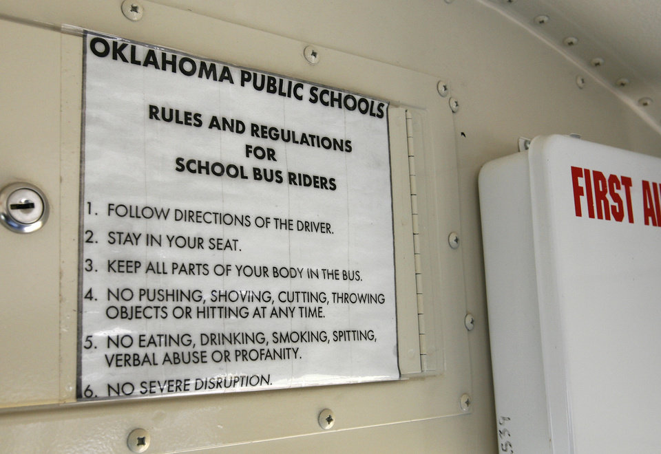 Photo - SIGN: Rules and regulations for school bus riders are posted at front of bus.  Oklahoma City Public Schools.    BY JIM BECKEL, THE OKLAHOMAN ORG XMIT: KOD