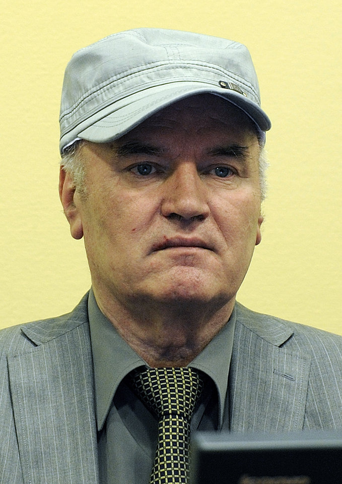 Photo -   FILE - In this Friday, June 3, 2011 file photo former Bosnian Serb Gen. Ratko Mladic is seen as he sits in the court room during his initial appearance at the U.N.'s Yugoslav war crimes tribunal in The Hague, Netherlands. Twenty years after Serb forces unleashed a brutal campaign of ethnic cleansing in Bosnia, their military commander Gen. Ratko Mladic is finally going on trial Wednesday May 16, 2012, on charges of masterminding atrocities throughout the country's devastating 1992-95 war.(AP Photo/ Martin Meissner, Pool, File)