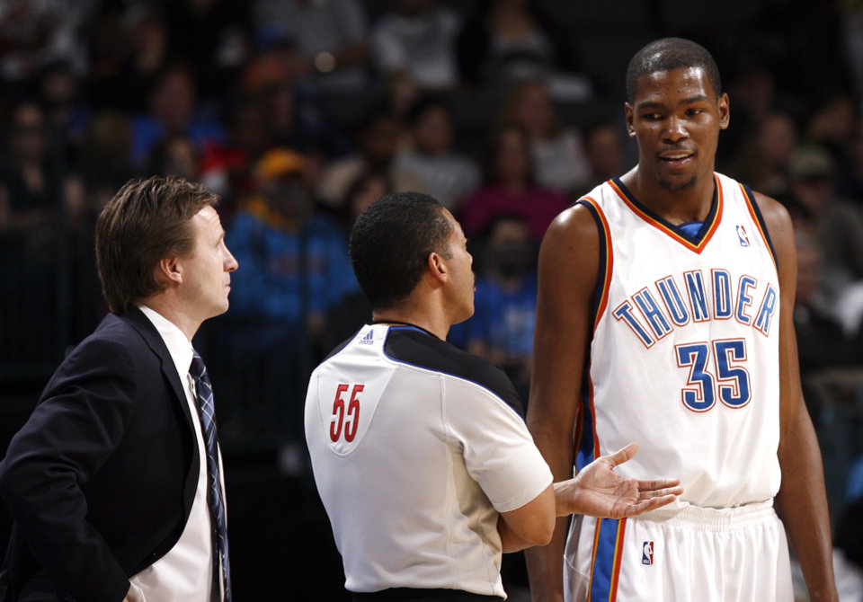 Photo - Oklahoma City's Kevin Durant (35) talks to a referee and head Coach Scott Brooks during the NBA game between the Oklahoma City Thunder and Golden State Warriors, Sunday, Jan. 31, 2010, at the Ford Center in Oklahoma City. Photo by Sarah Phipps, The Oklahoman