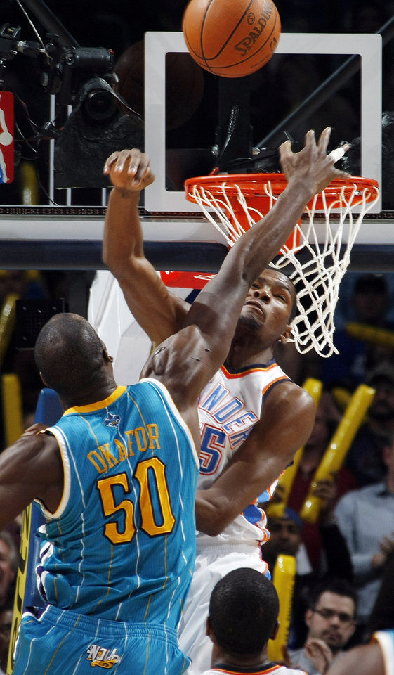 Photo - Oklahoma City's Kevin Durant (35) blocks a shot by Emeka Okafor (50) of New Orleans during the NBA basketball game between the New Orleans Hornets and the Oklahoma City Thunder at the Oklahoma City Arena in downtown Oklahoma City, Monday, Nov. 29, 2010. Oklahoma City won, 95-89. Photo by Nate Billings, The Oklahoman