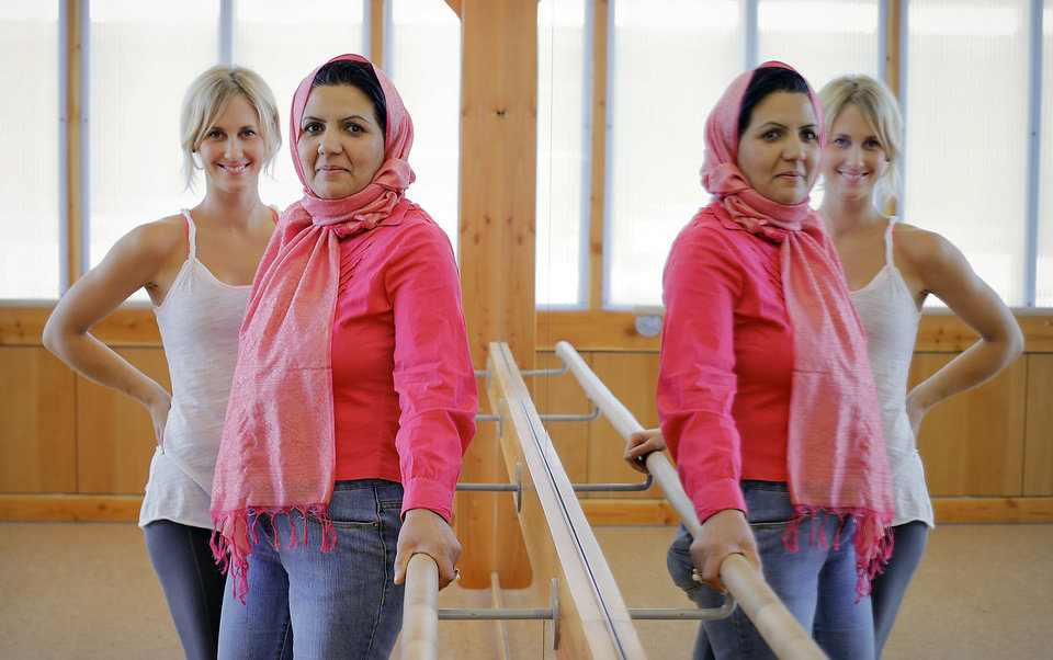 Photo - Afghan student Kobra Dastgirzada, center, poses with her mentor Andrea Mason at Barre3 fitness center. The mentorship is part of the Peace Through Business program of the Institute for Economic Empowerment of Women (IEEW). Photo by Chris Landsberger, The Oklahoman