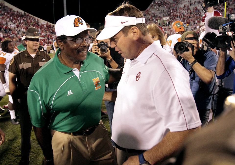 Sooner head coach Bob Stoops and Florida A&M head coach Joe Taylor speak after the college football game between the University of Oklahoma Sooners (OU) and Florida A&M Rattlers at Gaylord Family—Oklahoma Memorial Stadium in Norman, Okla., Saturday, Sept. 8, 2012. Photo by Steve Sisney, The Oklahoman