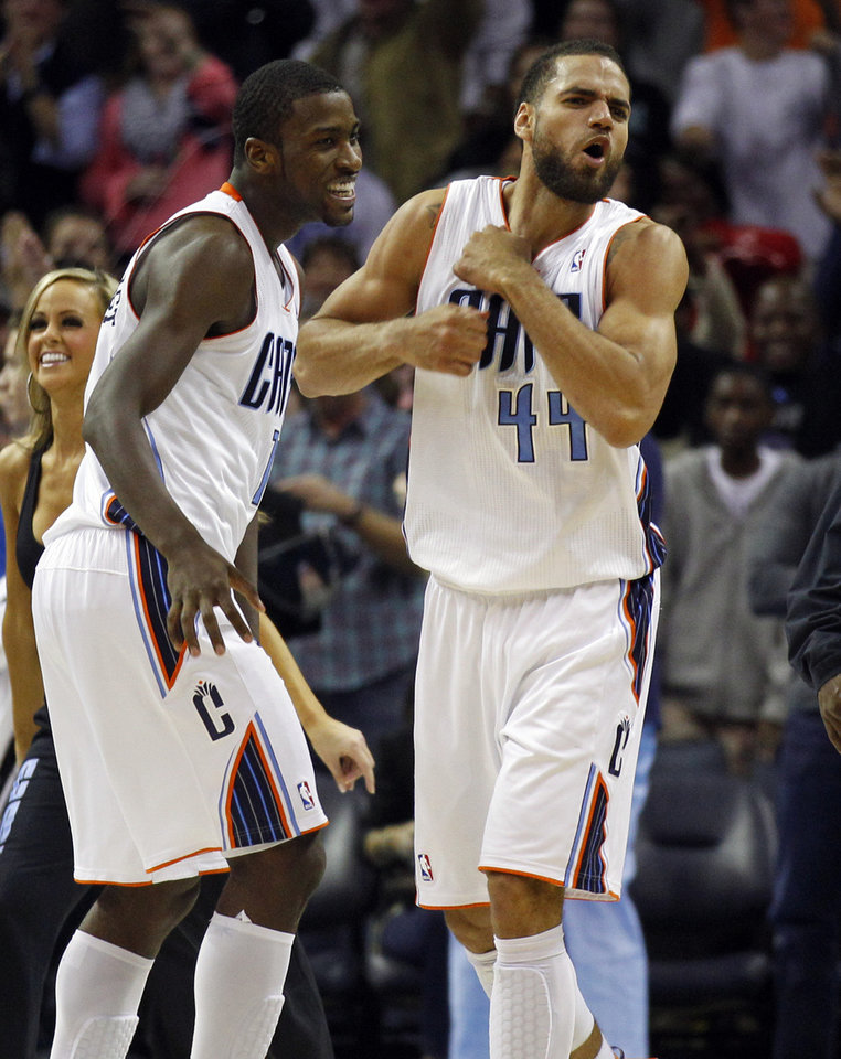 Photo -   Charlotte Bobcats' Jeffery Taylor, right, and Michael Kidd-Gilchrist, left, react after defeating the Toronto Raptors in an NBA basketball game in Charlotte, N.C., Wednesday, Nov. 21, 2012. The Bobcats won 98-97. (AP Photo/Chuck Burton)