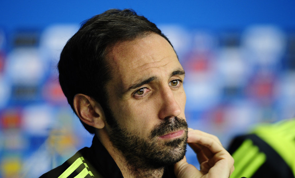 Photo - Spain's Juanfran gestures during an official press conference the day before the group B World Cup soccer match between Spain and Australia at the at the Arena da Baixada stadium in Curitiba, Brazil, Sunday, June 22, 2014. Spain will play in group B of the Brazil 2014 World Cup. (AP Photo/Manu Fernandez)