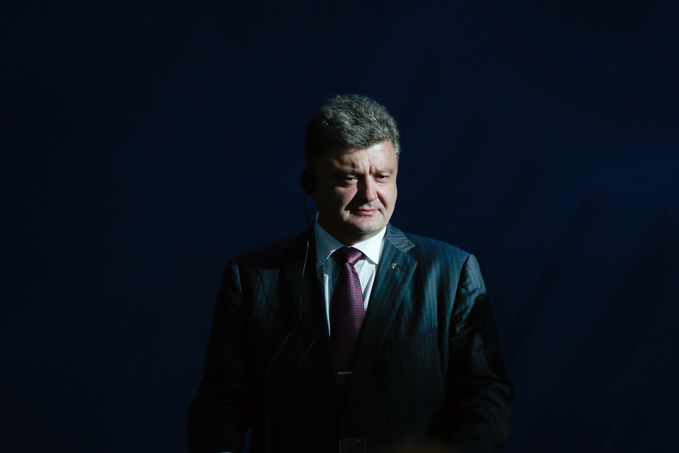 Photo - Ukraine president-elect Petro Poroshenko attends a joint news conference with German Chancellor Angela Merkel, prior to a meeting at the chancellery in Berlin, Thursday, June 5, 2014. (AP Photo/Markus Schreiber)