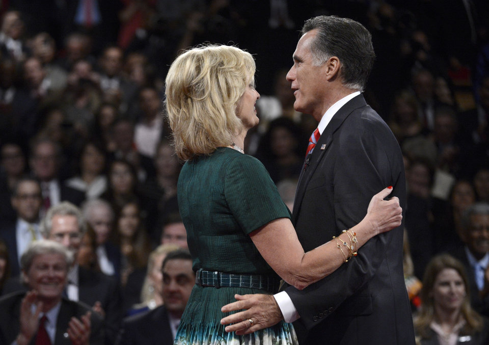 Photo -   Republican presidential nominee Mitt Romney and his wife Ann Romney embrace after the third presidential debate at Lynn University, Monday, Oct. 22, 2012, in Boca Raton, Fla. (AP Photo/Pool-Michael Reynolds)