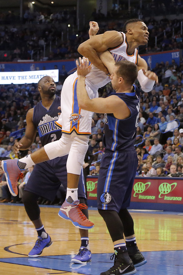 Photo - Oklahoma City's Russell Westbrook (0) gets tangled up with Dallas' J.J. Barea (5) during the NBA basketball game between the Oklahoma City Thunder and the Dallas Mavericks at Chesapeake Energy Arena on Wednesday, Jan. 13, 2016, in Oklahoma City, Okla.  Photo by Chris Landsberger, The Oklahoman