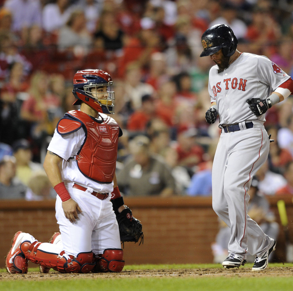 Photo - Boston Red Sox's Dustin Pedroia, right, scores on an RBI single by teammate Christian Vazquez as the St. Louis Cardinals' Tony Cruz looks out in the third inning in a baseball game, Thursday, August 7, 2014, at Busch Stadium in St. Louis. (AP Photo/Bill Boyce)