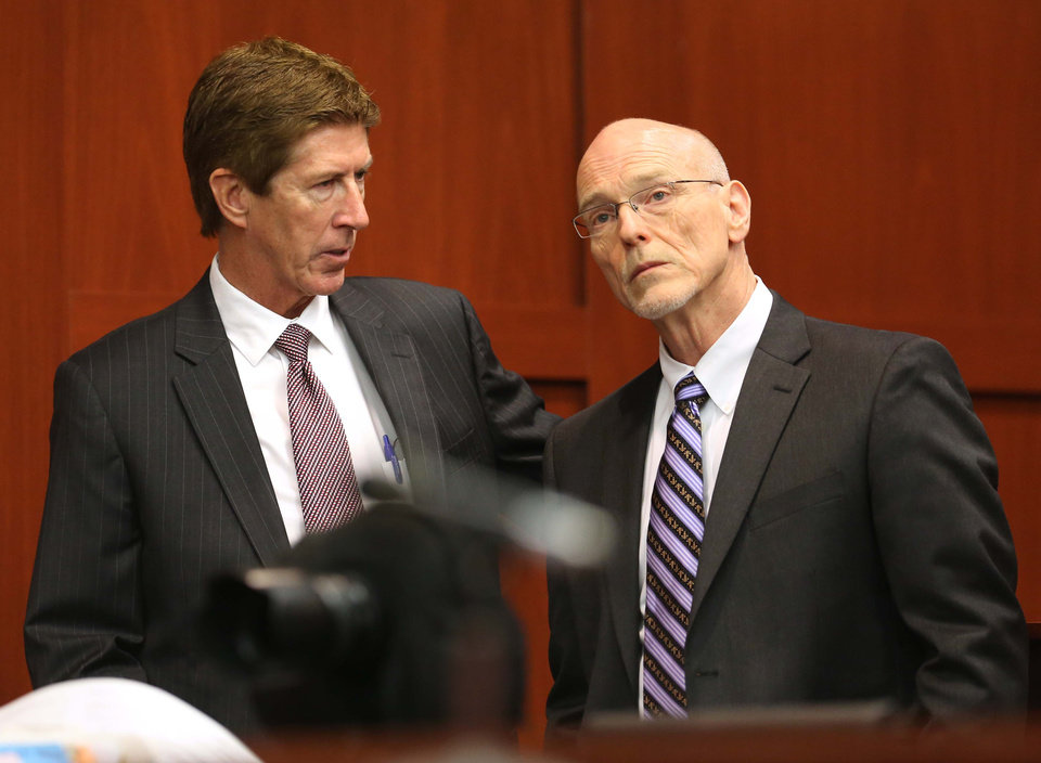 Photo - Defense attorney Mark O'Mara, left, confers with co-counsel Don West during the George Zimmerman trial in Seminole circuit court in Sanford, Fla., Wednesday, June 12, 2013. Zimmerman has been charged with second-degree murder for the 2012 shooting death of Trayvon Martin.(AP Photo/Orlando Sentinel, Joe Burbank, Pool)