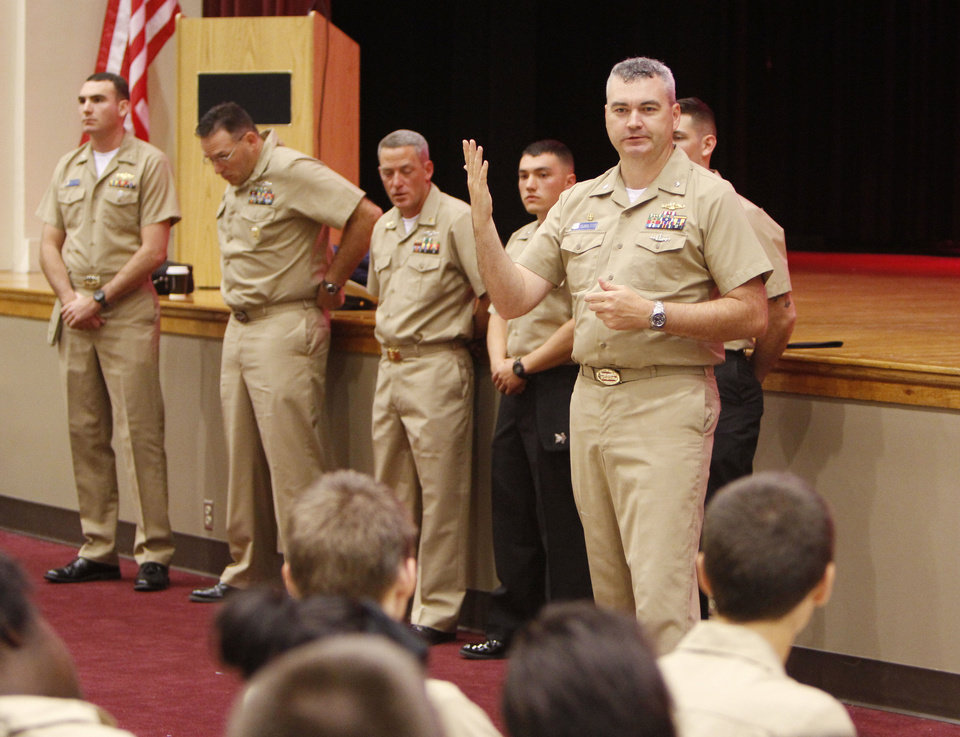 Students listen to Commanding Officer Andrew Peterson as the crew of USS Oklahoma City submarine meets with the Navy ROTC at Capitol Hill High School on Thursday. PHOTO BY PAUL HELLSTERN, THE OKLAHOMAN <strong>PAUL HELLSTERN - Oklahoman</strong>