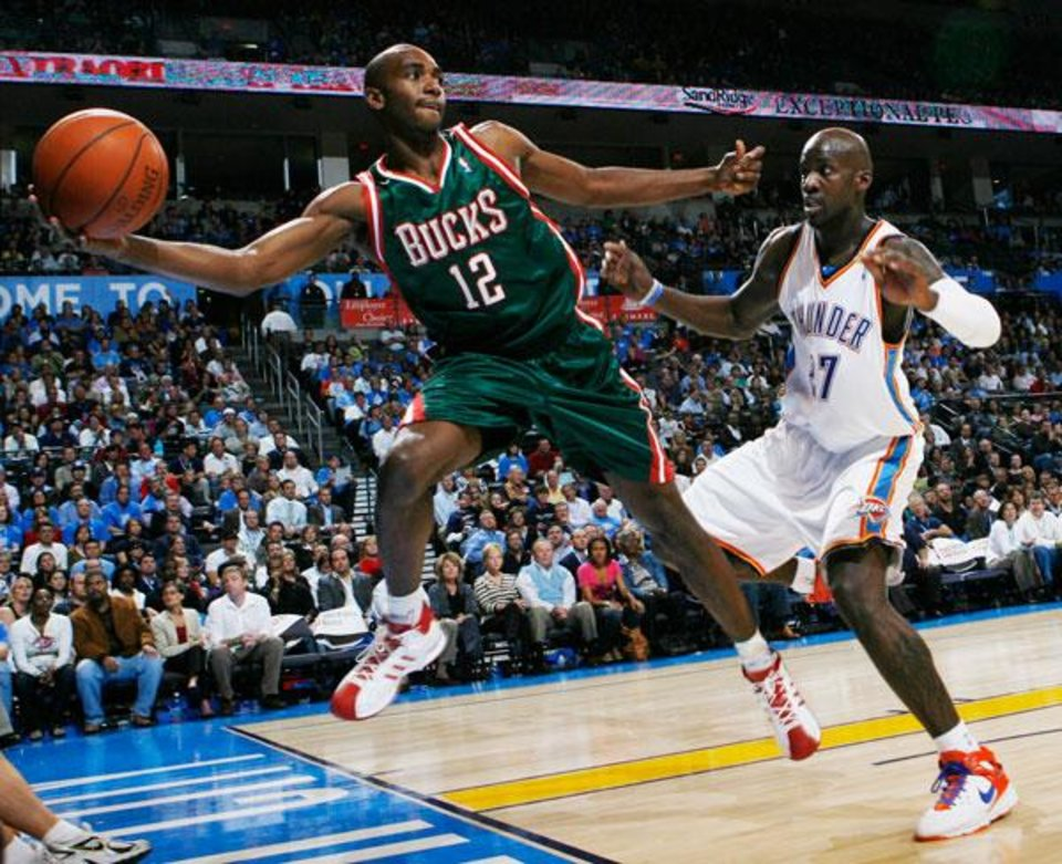Photo -  Luc Richard Mbah a Moute (12) of the Bucks saves the ball from going out of bounds in front of Johan Petro (27) of the Thunder during the NBA basketball game between the Oklahoma City Thunder and the Milwaukee Bucks at the Ford Center in Oklahoma City, Wednesday, Oct. 29, 2008. This was the regular season debut of the Thunder. BY NATE BILLINGS, THE OKLAHOMAN