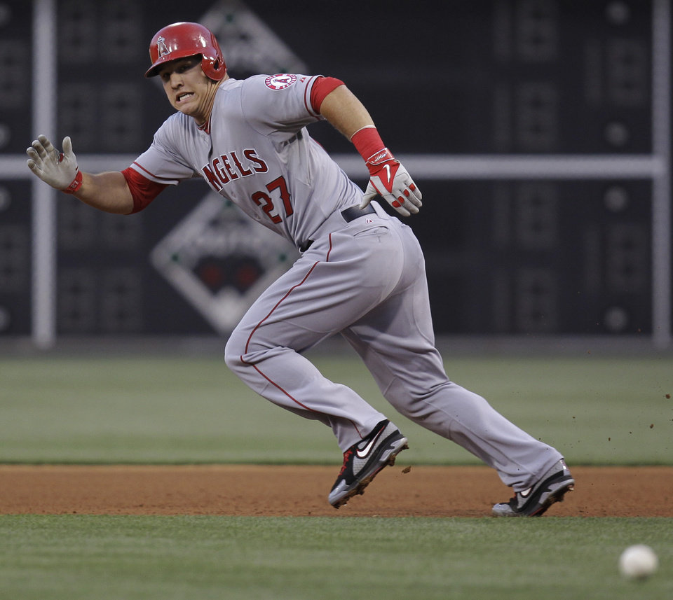 Photo - Los Angeles Angels' Mike Trout runs to second but is tagged out in the fourth inning of a baseball game with the Philadelphia Phillies, Tuesday, May 13, 2014, in Philadelphia. (AP Photo/Laurence Kesterson)