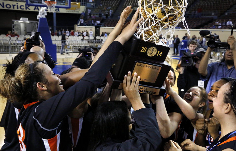 Photo - Preston players celebrate after receiving the state championship trophy at the end of the Class 2A Girls State Championship game between Preston and Cordell at Jim Norick Arena at State Fair Park  on Saturday, Mar. 15, 2014.  Preston won,  45-41. Photo by Jim Beckel, The Oklahoman