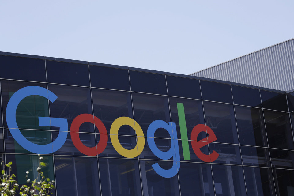 Photo - FILE - This July 19, 2016, file photo shows the Google logo at the company's headquarters in Mountain View, Calif. The company announced a $600 million expansion at its data center near Pryor, Oklahoma. (AP Photo/Marcio Jose Sanchez, File)