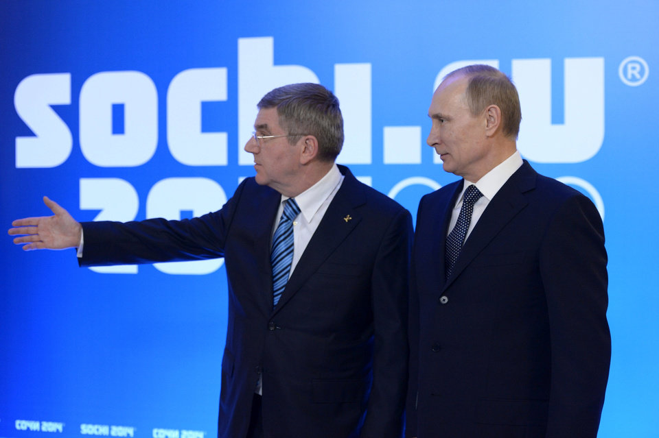 Photo - Russian President Vladimir Putin, right, greets International Olympic Committee President Thomas Bach at an event welcoming IOC members ahead of the upcoming 2014 Winter Olympics at the Rus Hotel, in Sochi, Russia, Tuesday, Feb. 4, 2014. (AP Photo/RIA-Novosti, Alexei Nikolsky, Presidential Press Service)